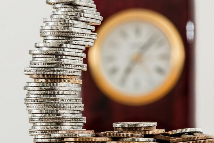 Stack of Coins with Clock at the back